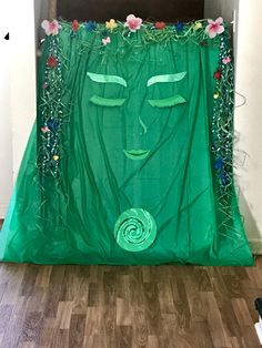 All of the items to make Te Fiti were purchased from the Dollar Tree. We used Floral Grass and Ribbon for the hair. Poster board to make the face and spiral. And the glitter for the spiral and eye brows.