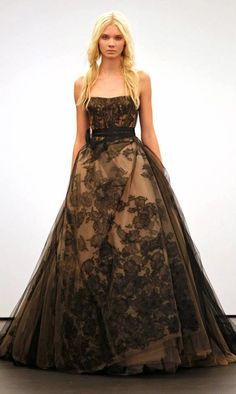 A BLACK WEDDING DRESS!!!  This is quite different.  From Munaluchi Bridal Magazine