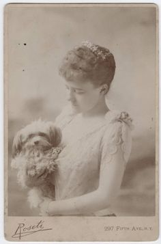 Edith Wharton as a young woman, c. 1889. With one of her omnipresent dogs in tow.