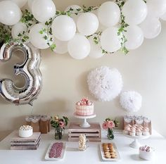 white balloons w/floral accents