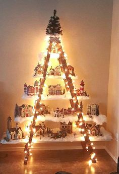 "Here's a lovely idea to do if you have an old ladder in the garage! Make a beautiful Christmas village with lights and houses! This was made by Lydia Mendoza. She says ""I had an old ladder from a yard sale. I put planks of wood that I painted white on the steps to form …"