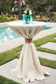 Hi top tables for reception. Simple white linen with burlap bow.