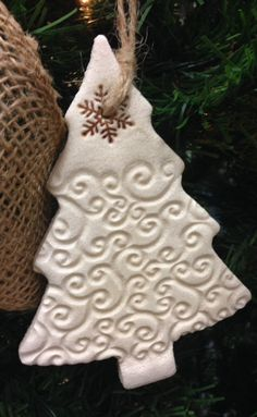 Rustic Salt Dough Christmas Tree Ornament with simple swirl imprint. Hand-stamped salt dough tree ornament, Ivory color with stamped snowflake at top. Each tree measures 5.5 x 4. Twine hanger. Recommended for indoor use only. Ornaments have a clear coat matte finish. 10% of all OneRusticHeart sales will be donated to OneByOne Ministries. http://www.onebyone.net