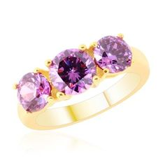 AAA Simulated Amethyst (Rnd) Trilogy Ring in 14K Gold Overlay Sterling Silver 6.250 Ct. I have this ring and it's gorgeous! bought it as a gift but liked it so much. It sparkles intensly much more than a real Amethyst would as they aren't very refractive. I have had it for a year and still looks amazing. All for an amazing price too.£8 but hurry last few.