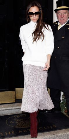 December 14, 2014 - Victoria Beckham stepped out and braved the London chill with a chunky white knit and a shin-grazing speckled wool skirt, with a dark clutch and tall maroon suede boots. #InStyle