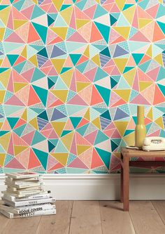 This wallpaper offers a pop of color  and matching accessories.