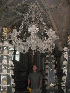 This is a friend of ours standing under the great chandelier.  The ossuary is estimated to contain the skeletons of between 40,000 and 70,000 people, whose bones have in many cases been artistically arranged to form decorations and furnishings for the chapel.