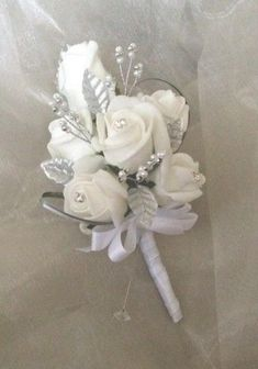 Weddbook is a content discovery engine mostly specialized on wedding concept. You can collect images, videos or articles you discovered organize them, add your own ideas to your collections and share with other people | Ladies Corsage Buttonholes Wedding Flowers White and Silver New