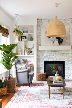 This is a gorgeous white painted fireplace. Love how bright it is. Have you ever wondered how to paint a fireplace? Look no further!
