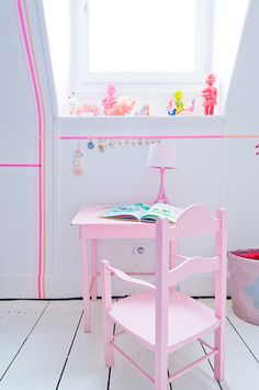 Love the pink stripes created around the room with tape. Kids room by © Julien Fernandez