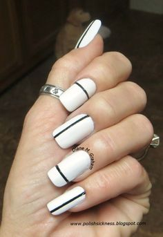 Black And White Nail Designs We Love : Copy this look by using tape to make thin lines on plain white nails, and use black polish create a simple stripe on each nail. Black And White Nail Designs, Black Nail Art, Black Polish, Black White, White Art, Red And White Nails, Nail Art Photos, Lines On Nails, Geometric Nail Art