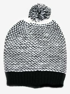 Pull your outfit together with this modern pom pom beanie.