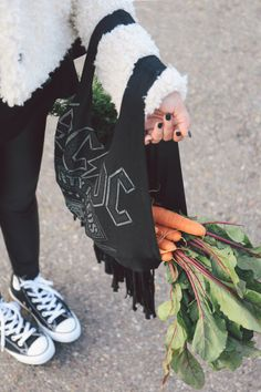 Make a tote bag out of a shirt that's been sitting in your closet. | 26 Easy Style Hacks To Turn An Old Tee Into A Head-Turner