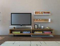 A TV unit gives you easy access to all the cables and sockets should you need to change them, while keeping a straight TV. That's why you need our AYAZ Teak and White TV Unit for only $313.41!  Tags: #doseofmodern #furniture #furnituredesign #cali #visitcalifornia #sanfrancisco #la #woodworking #interior #sofa #sandiego #socal #homedecor #decor #decoration #wood #westcoast #woodwork #instadesign #furnituremurah #table #interiors #homedesign #chair #livingroom #igerssf #bayarea #hollywood #modern Tv Unit Furniture, Modern Furniture, Furniture Design, White Tv Unit, Teak, Bedroom Wall, The Unit, House Design, Living Room