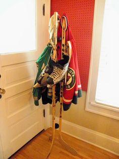 Hockey stick coat hanger
