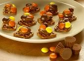 Make the REESE'S Pretzel Snacks recipe from REESE'S and please the crowd at your next college football party or tailgate!