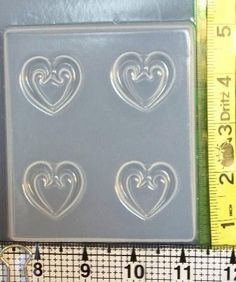 Four cavity heart jewelry resin mold 610 has 4 scroll hearts that are about 1 1/4 inches wide by 1 inch tall. The cavities are about 1/4 inch deep. This mold will cast hearts with open centers. How to