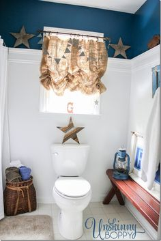 White on the bottom, dark blue on top, shelf in between.  Love this rustic boys bathroom from Unskinny Boppy!
