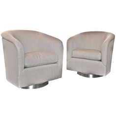 A Pair of Swivel Chairs in Linen by Milo Baughman, USA, c. 1970s | From a unique collection of antique and modern chairs at http://www.1stdibs.com/furniture/seating/chairs/