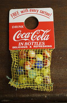 Coca Cola marbles promotion - free bag of marbles hung on neck of one bottle in each carton, circa 1950s-70s.