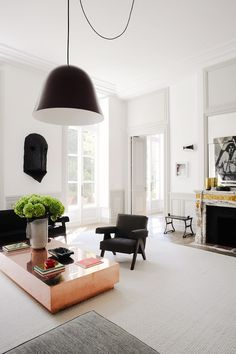 Black and white Parisian apartment with green hydrangeas