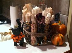 Indian Corn around candle in fall display