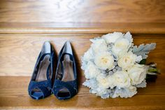 White and grey bridal bouquet. White patience roses, navy shoes  Carley Rehberg Photography