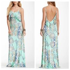 Shop Women s Tart size L Maxi at a discounted price at Poshmark.  Description  TART Reptile Flounce Maxi Dress ~ Worn Once ~ Beautiful ~  Perfect 6f4d687bb