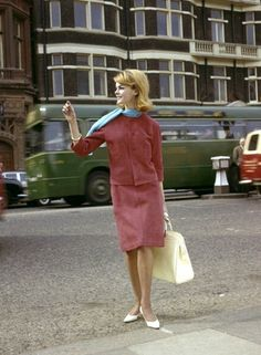 Early fashion shot of Jean Shrimpton wearing a red suede suit, London, 1962
