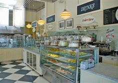 Magnolia Bakery Interior - like the L-shaped counter set up - one side for display and one for watching the baking and decorating.