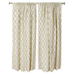 Add a pop of pattern to your master suite or guest room with this lovely cotton curtain, showcasing a trellis motif in green and ivory. Made in the USA.