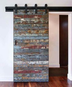 Not your ordinary barn door: Salvaged marine wood from a 40 year old bait barge which was destroyed by a swell in the Pacific Ocean from the 2011 Tsunami that hit Japan. We were lucky to get the remaining pieces to create this one of a kind sliding door! Diy Interior, Interior Barn Doors, Interior Design, French Interior, Scandinavian Interior, Modern Interior, Interior Decorating, Wooden Sliding Doors, Wooden Windows