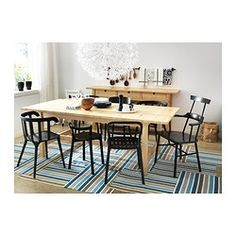 Extendable dining table with 1 extra leaf seats 8-10; makes it possible to adjust the table size according to need.