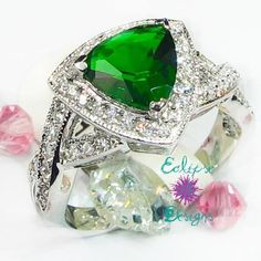 'Sz 6,7, & 9 SS Sim Peridot Zircon Trillion Ring' is going up for auction at  7am Sat, Mar 9 with a starting bid of $12.