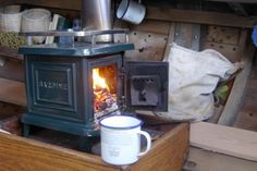 Shipshape Heater - burns wood or coal .  Sardine marine stove by Navigator Stove Works $1090 for the plain iron model