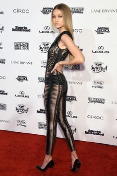 16 February Gigi Hadid showed off her supermodel figure in a cut-out black catsuit by Julien Macdonald for a Sports Illustrated party in New York. - HarpersBAZAAR.co.uk