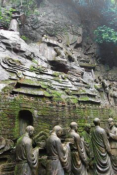 Ancient sculpture into a cliff.   China