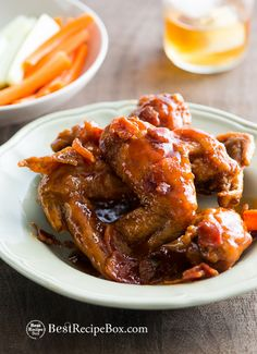 Sticky Maple Bourbon Bacon Chicken Wings Recipe. The sauce is to die for ane perfect for game day on BestRecipeBox.com