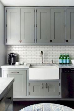 Gray and white kitchen backsplash ideas gray recessed panel cabinets white subway tile with gray grout . gray and white kitchen backsplash Gray Kitchen Countertops, White Kitchen Backsplash, Kitchen Tiles, Kitchen Flooring, New Kitchen, Backsplash Ideas, Kitchen Grey, Kitchen Sink, Kitchen Wood