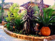 Artificial Rock edging of flower bed by Designer Gardens Landscaping www. Rock Edging, Artificial Rocks, Flower Beds, Garden Landscaping, Garden Design, Gardens, Landscape, Flowers, Plants