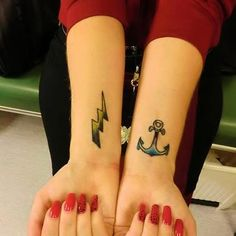 hope and chaos, and the right one is a copy of Amy Winehouse Lightning tattoo, made it Before her Death cuz i loved her she was so talented and a tribute.
