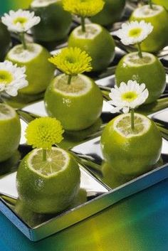 Love the idea of real limes on the table with a single flower. Not only will it smell great, it will also be cheap too!