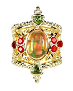 Mexican fire opal ring by Paula Crevoshay