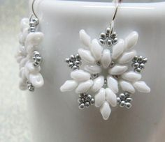 White glass pearl beads snowflake earrings