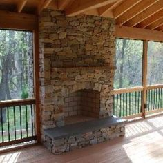 Stone stacked massive corner fireplace on wooden deck for Wood burning stove for screened porch
