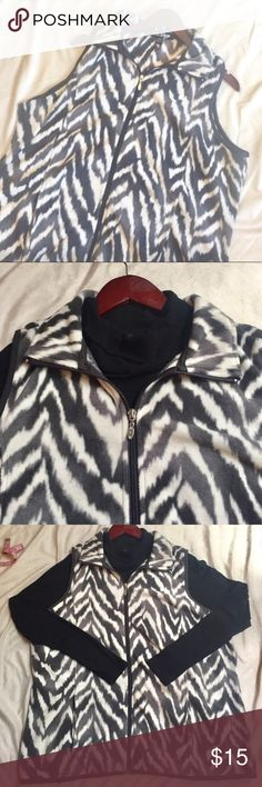 Fleece Zebra Print Vest Size XL Plus Size Zebra print Vest.  •Great layering piece. •2 pockets.  •Comfy and Soft.  •Size 14/16.  •Used, no significant signs of wear. •Good condition.                                                                 •Model Photo is not of product, used as styling guide. Jackets & Coats Vests