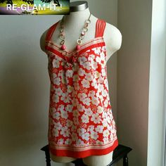 LC LAUREN CONRAD. ....GORGEOUS FLOWER ...TOP ...EXCELLENT CONDITION  ...LIKE BRAND NEW ...NO FLAWS  ...GORGEOUS  ...A MUST HAVEEEE  ...true to its size and color ...comfortable  ...LOOSE FEEL TOP ...color...multiple  ...2 pic up close ...sleeveless  ...flower design throughout  ...stripe design ...X shape back ...MTRL. ...adding soon ...better in person.. LC Lauren Conrad Tops Blouses
