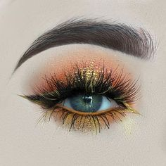 eye with gold bronze and orange eye shadows
