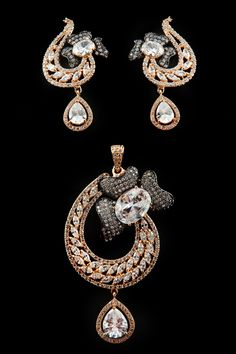 Round and marquise shape american diamond pendant set with black rhodium in gold plating
