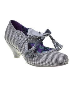 Sophisticated style with high-fashion funk, these mary jane pumps feature a classic gingham print and a tassel-trimmed ribbon bow across the instep.